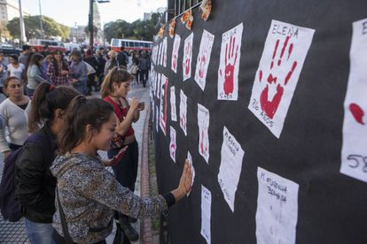 Women pay homage to the victims of male violence.