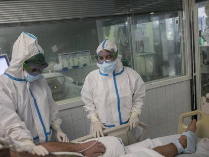 A patient is treated in the ICU at the Mar de Barcelona hospital in Catalonia.