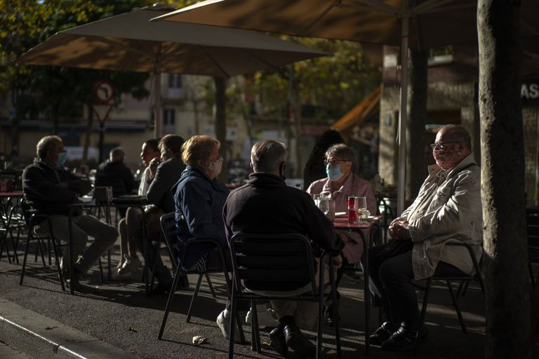 Patrons wear face masks at a sidewalk café in Barcelona on Wednesday.