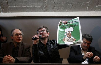 Gérard Biard, Luz and Patrick Pelloux, with the front cover of the edition of Charlie Hebdo published straight after the attack.