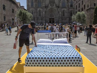A bed placed by City Hall in Barcelona's Plaza de la Catedral.