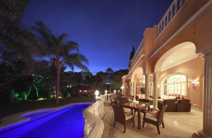The terrace and pool by night.