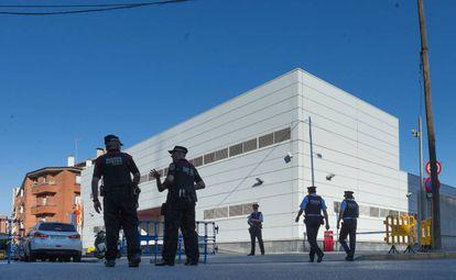 Officers outside the police station in Cornellà de Llobregat.