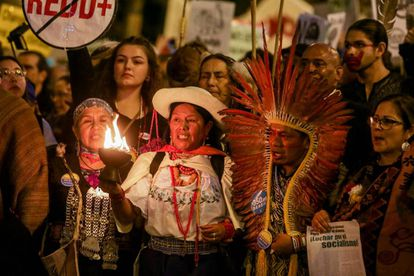 Indigenous Chilean activists at the march in Madrid.