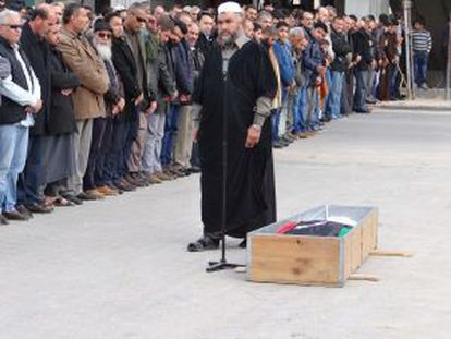 Mourners pay tribute to brigade commander Tareq Shanina in Misrata on December 23.