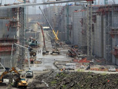 Work on the Panama Canal (above) was due to finish in October 2014.
