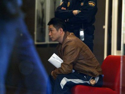 Gao Ping, pictured during the police raid on his Madrid art gallery last week.