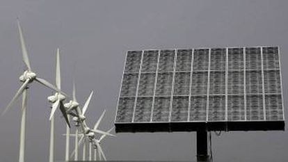 Wind turbines and photovoltaic panels, two regular features of the Spanish landscape.