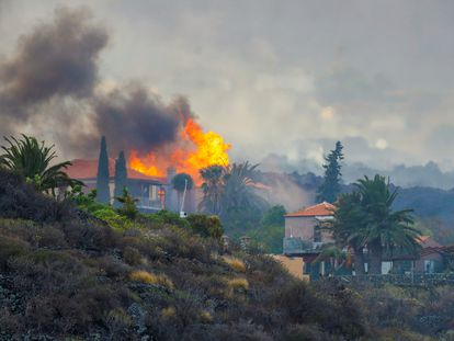 A house burns following the volcanic eruption in the Canary Island of La Palma.