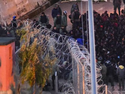 Moroccan police stop migrants from crossing into the Spanish exclave city of Ceuta in this file photo.