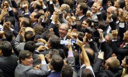 Eduardo Cunha (center), the president's political nemesis, recently became speaker of the lower house.