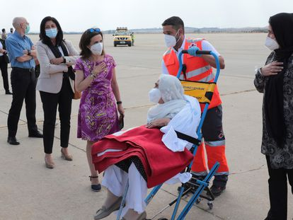 Defense Minister Margarita Robles greets an Afghan evacuee at the Torrejón de Ardoz air base on Wednesday.