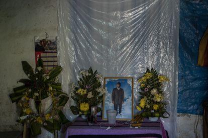 Edgar López's family has placed an altar to him in their house.