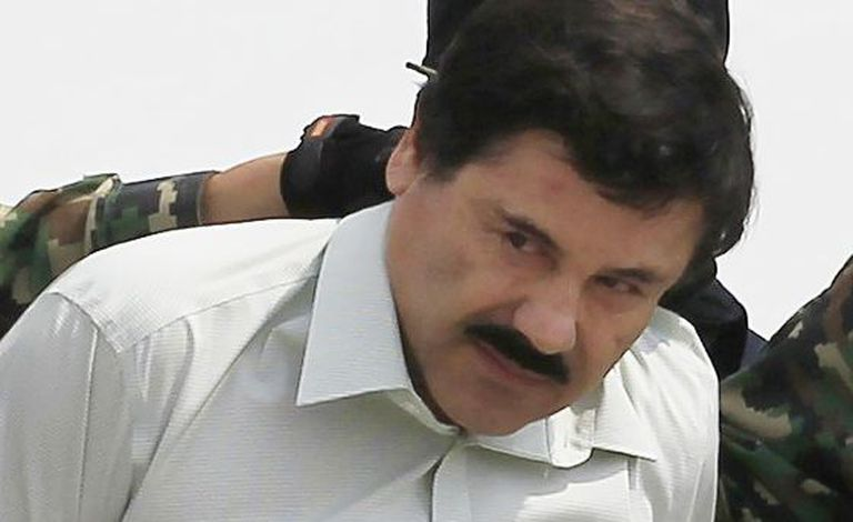 Joaquin 'El Chapo' Guzman is escorted by soldiers during a presentation at the navy's airstrip in Mexico City in 2011.