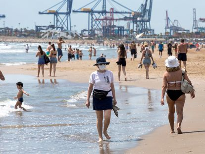 Beachgoers at the Mavarossa beach in Valencia on Monday.
