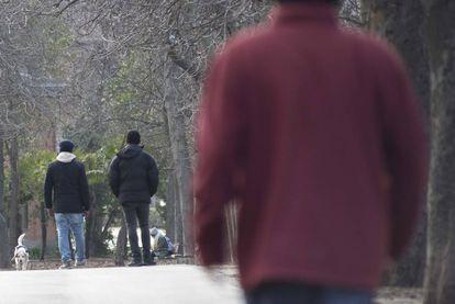Two petty drug dealers in Madrid's Retiro park.