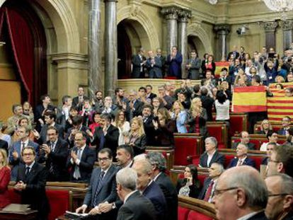Spanish and Catalan flags on display inside the Catalan parliament after the historic vote on the separatist motion.