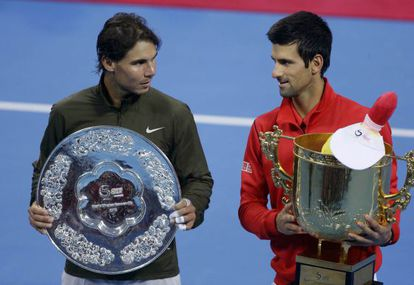 Spain's Rafael Nadal (l) and Novak Djokovic of Serbia pose with their trophies after their men's singles final match at the China Open.