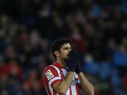 Diego Costa rues a missed chance in a cup match against Valencia.