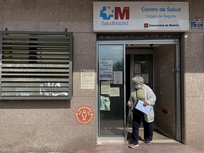 A woman leaving a primary healthcare center in Madrid.