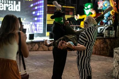 Two nightclub workers in fancy dress provide a photo op for tourists at Coco Bongo.