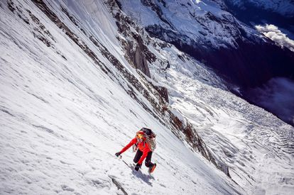 Ueli Steck ascending Annapurna in the Himalayan mountains.