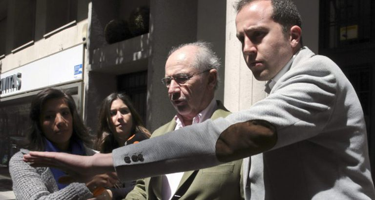 Rodrigo Rato walking out of his Madrid home on Sunday.