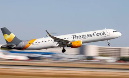 A Thomas Cook plane leaves Palma de Mallorca.