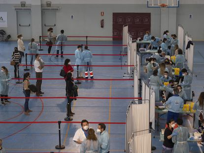 Essential workers are given the AstraZeneca vaccine in Seville.