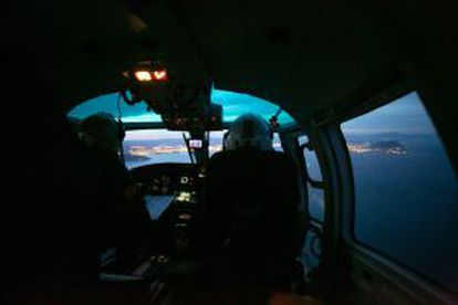 A surveillance helicopter flies out of Los Barrios, near Algeciras, several times a day in search of drug-laden boats.