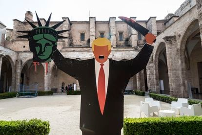 A reproduction of Edel Rodriguez's infamous illustration of Donald Trump holding the Statue of Liberty's head on display at the Carme Center of Contemporary Culture in Valencia.