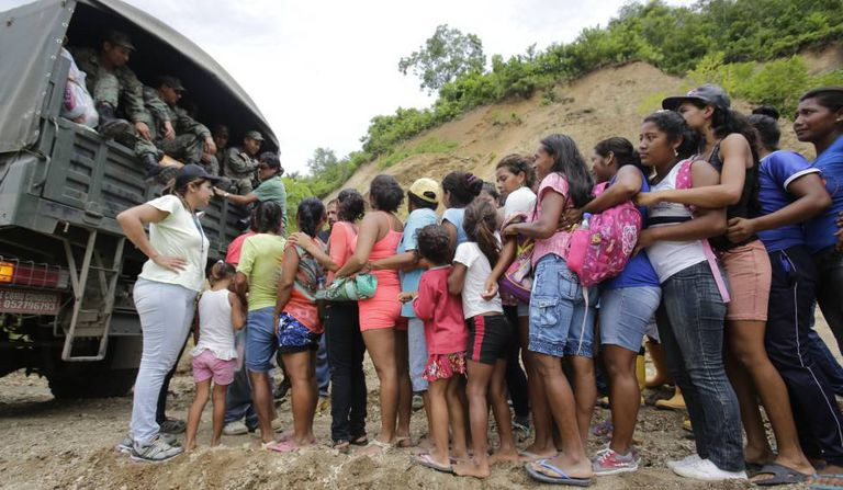 People affected by the quake lining up for help.