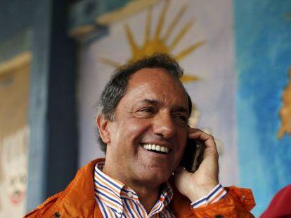 Daniel Scioli speaks on his cellphone on Sunday.