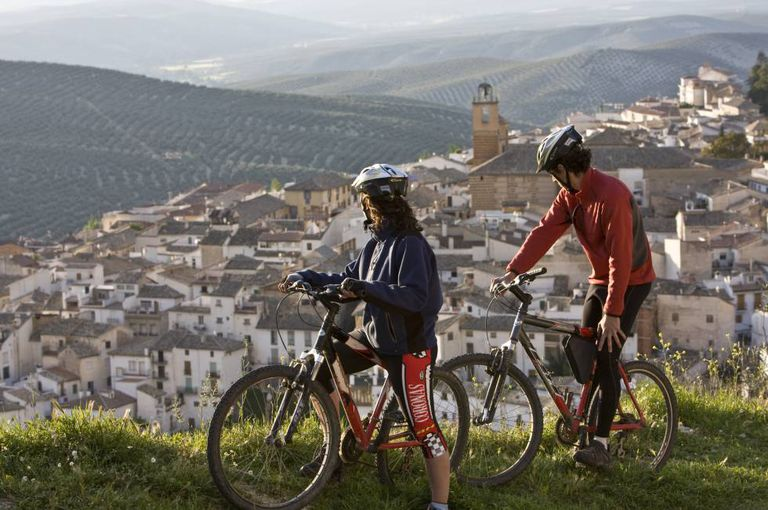Cyclists enjoying a view of the village of Cazorla, in Jaén province.