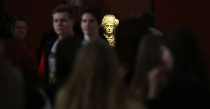 The famous 'Lady of Elche,' surrounded by visitors at the National Archeology Museum in Madrid.