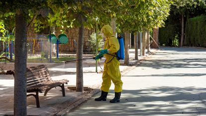 A worker disinfects an area near a senior home in Burbáguena, Teruel.