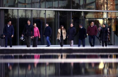 Workers at energy firm Iberdrola leave their offices at the end of the day.