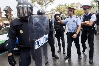 Catalan police and riot officers argue during the October 1 referendum.