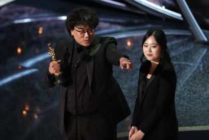 """Director Bong Joon-ho accepts the Oscar for Best Foreign Language Film for """"Parasite"""" on February 9, 2020."""