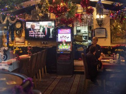 A television in a bar in Gibraltar shows a commercial for the British election debate.