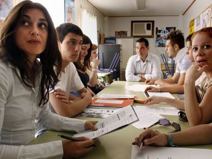 Young people attend a class at an adult learning center in Alicante.