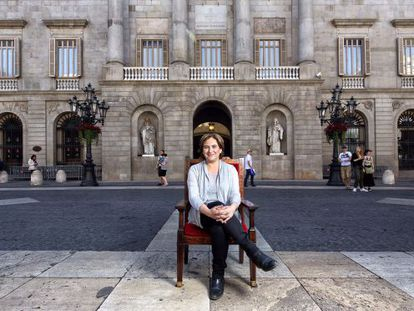 Ada Colau, sitting in front of Barcelona City Hall.