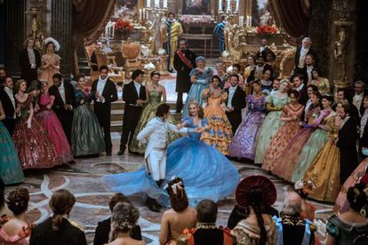 Having a ball: Lily James dances with her Prince Charming Richard Madden in 'Cinderella.'