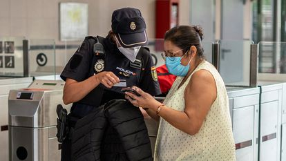 Police check at the Entrevias Metro station in Madrid on Monday.