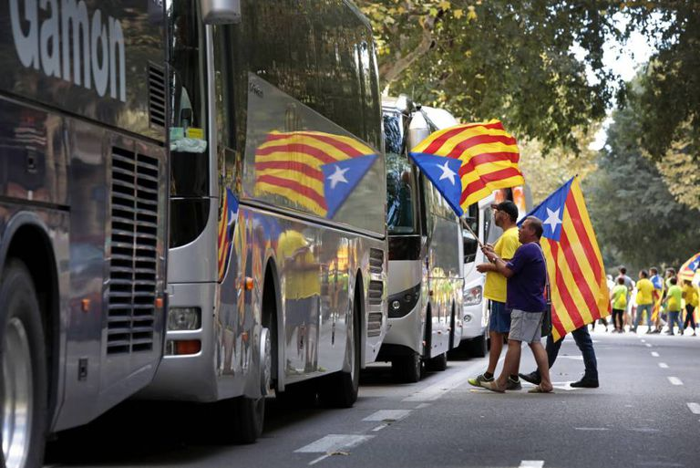 Pro-independence supporters board buses to attend La Diada, or Catalan National Day.