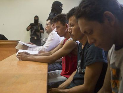 Three men arrested for their alleged participation in the massacre.