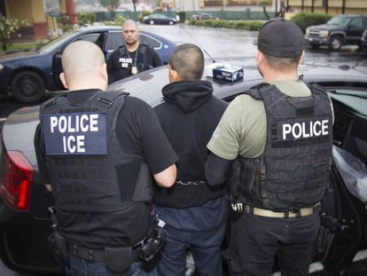 Immigration officers detain a suspected undocumented migrant on February 7 in Los Angeles.