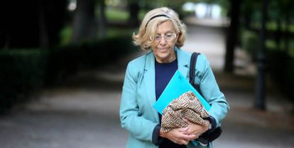 Manuela Carmena heading to Madrid City Hall on her first day on the job.