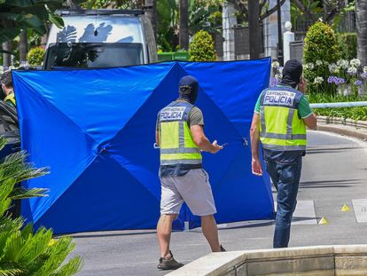 Police at a crime scene in Marbella, Spain, where a man was shot dead by a hitman in June.