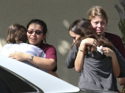 Students from Parkland hug one another after the school shooting.